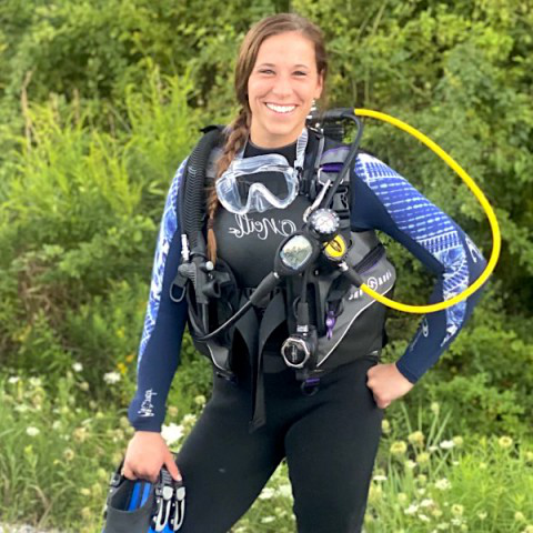 Sarae Sager (D.O., '21) is part of a group currently diving to the bottom of the Saco River to help remove waste left behind by partying river goers.