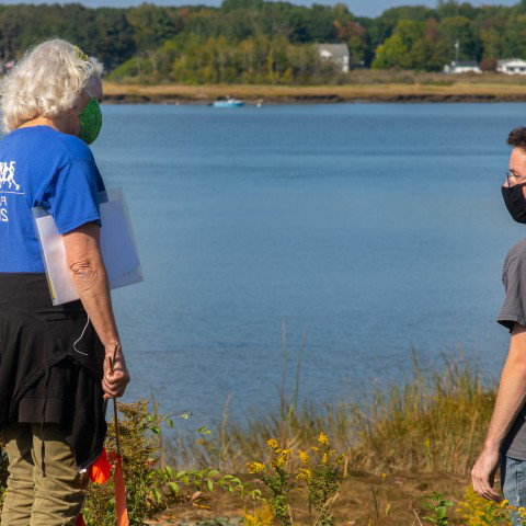 Pam Morgan, center, and students on the shoreline in Biddeford.